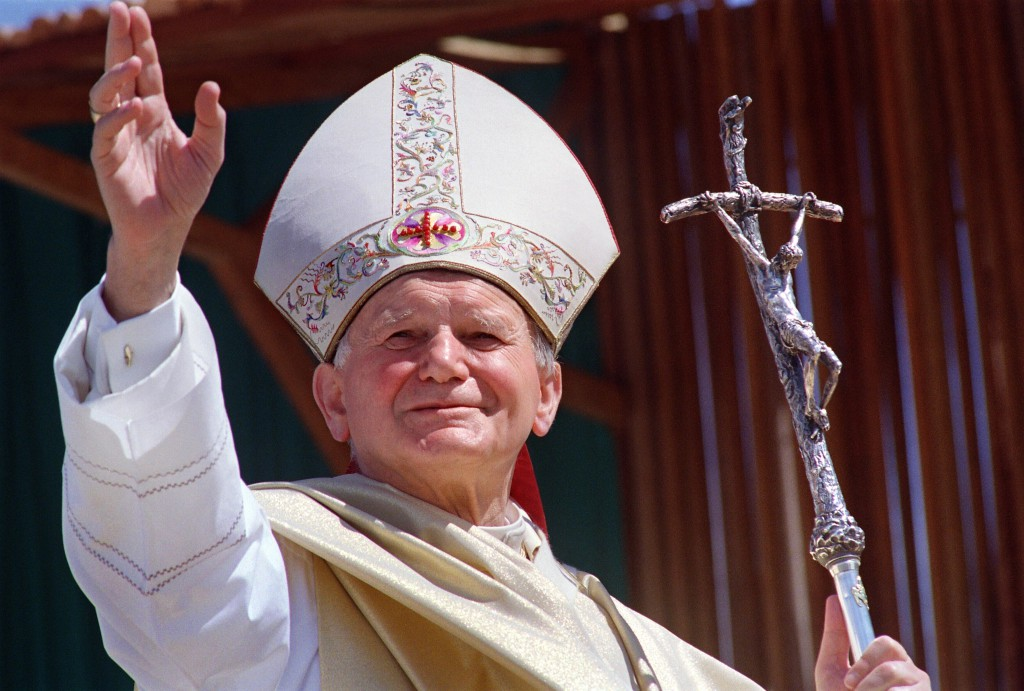 Pope John Paul II waves to the wellwisher 28 April