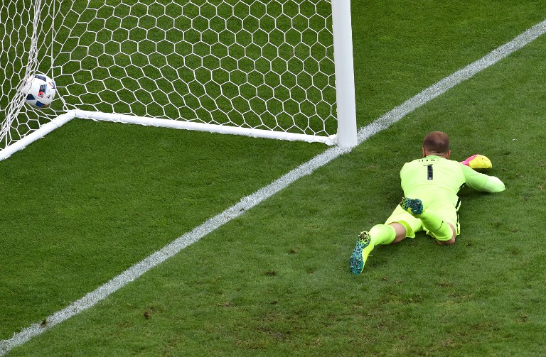 England's goalkeeper Joe Hart fails to save the ball during the Euro 2016 group B football match between England and Wales at the Bollaert-Delelis stadium in Lens on June 16, 2016. / AFP PHOTO / PHILIPPE HUGUEN