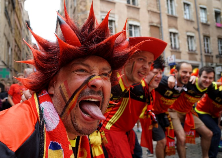 Belgium fans celebrate in the city of Lyon in eastern France, on June 13, 2016, prior to their Euro 2016 football match against Italy  / AFP PHOTO / VINCENZO PINTO