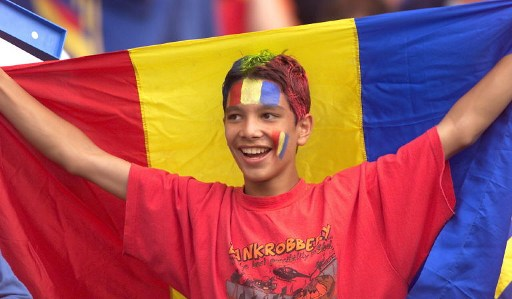 A Romanian supporter waves his national flag 22 June at Toulouse Stadium before the1998 Soccer World Cup group G match between England and Romania.  (ELECTRONIC IMAGE) AFP PHOTO Gerry PENNY / AFP PHOTO / GERRY PENNY