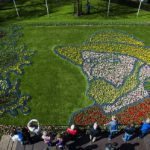 """People look at Tulips planted to form a portrait of Dutch painter Vincent van Gogh Keukenhof  flower garden in Lisse on April 21, 2015. The flower garden's theme is """"Van Gogh"""" for the 2015 season, marking the 125th anniversary of his death.  AFP PHOTO / ANP / REMKO DE WAAL  **NETHERLANDS OUT** / AFP PHOTO / ANP / REMKO DE WAAL"""