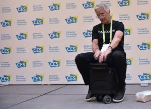 An exhibitor demonstrates the MODOBAG at the Venetian during CES 2018 in Las Vegas on January 9, 2018.  The bag is a carry-on suitcase which converts into a scooter. / AFP PHOTO / MANDEL NGAN