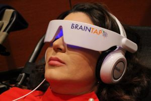 "Maria Paula Ochoa of Telemundo tries BrainTap technology designed to ""reboot busy brains"" by inducing meditative states of mind at the CES 2018 in Las Vegas on January 9, 2018.  / AFP PHOTO / Glenn CHAPMAN"