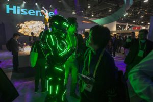 "A person dressed as a so-called ""glowbot"" entices people to the Hisense booth at CES in Las Vegas, Nevada, January 9, 2018.  / AFP PHOTO / DAVID MCNEW"