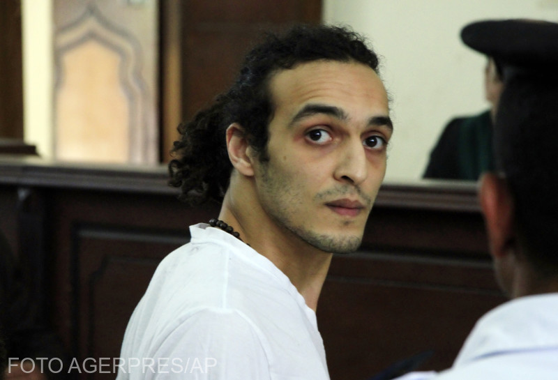 FILE - In this Thursday, May 14, 2015 file photo, Egyptian photojournalist Mahmoud Abou Zeid, known by his nickname Shawkan, appears before a judge for the first time after spending more than 600 days in prison in Cairo, Egypt. The United Nations' cultural agency has ignored warnings from Egypt and awarded the World Press Freedom prize to an imprisoned Egyptian photographer. A jury panel for UNESCO on Monday, April 23, 2018 gave the honor to Mahmoud Abu Zeid, known as Shawkan. He has been jailed since his August 2013 arrest in Cairo while covering a demonstration at Rabaa Al-Adawiya Square. (Lobna Tarek/El Shorouk Newspaper via AP, File )